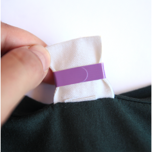 come applicare etichette adesive vestiti